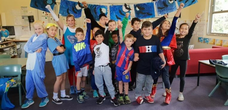Image of students dressed as super heros